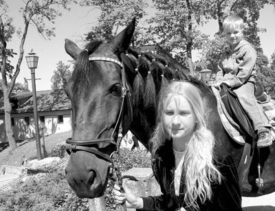 Zirga mugurā
